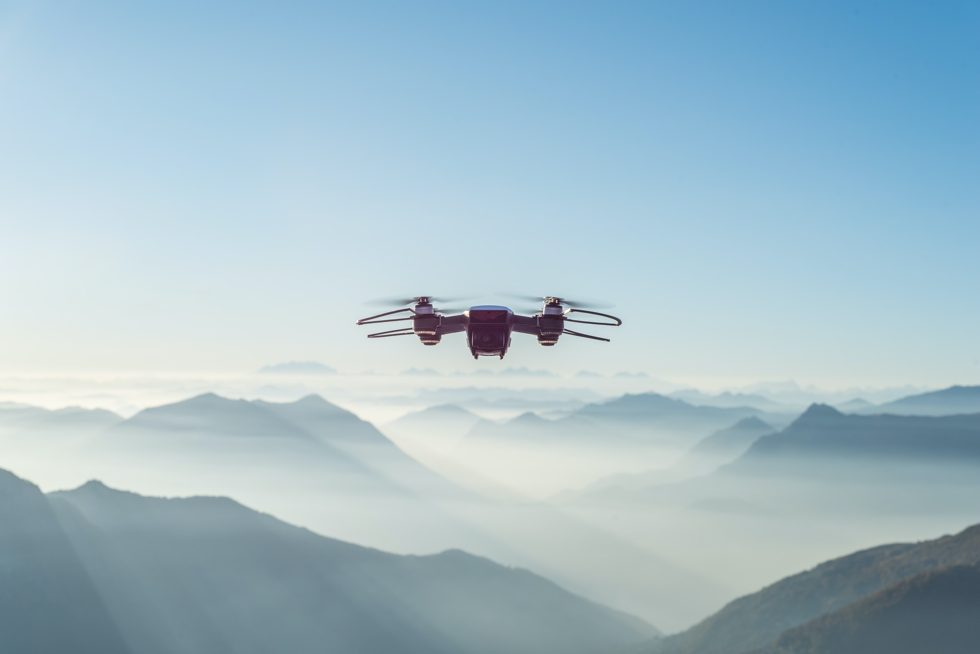 IoT drone used in the sky above mountains