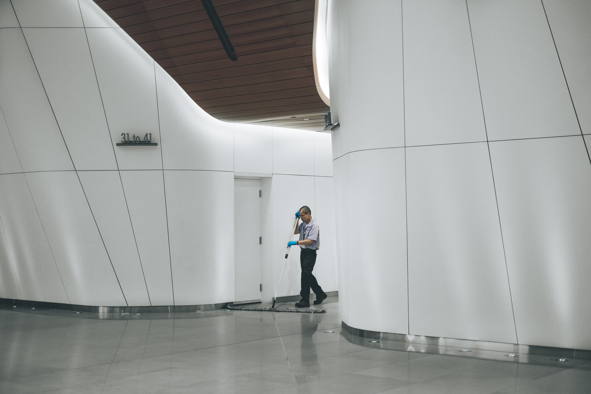 man cleaning reception area of office