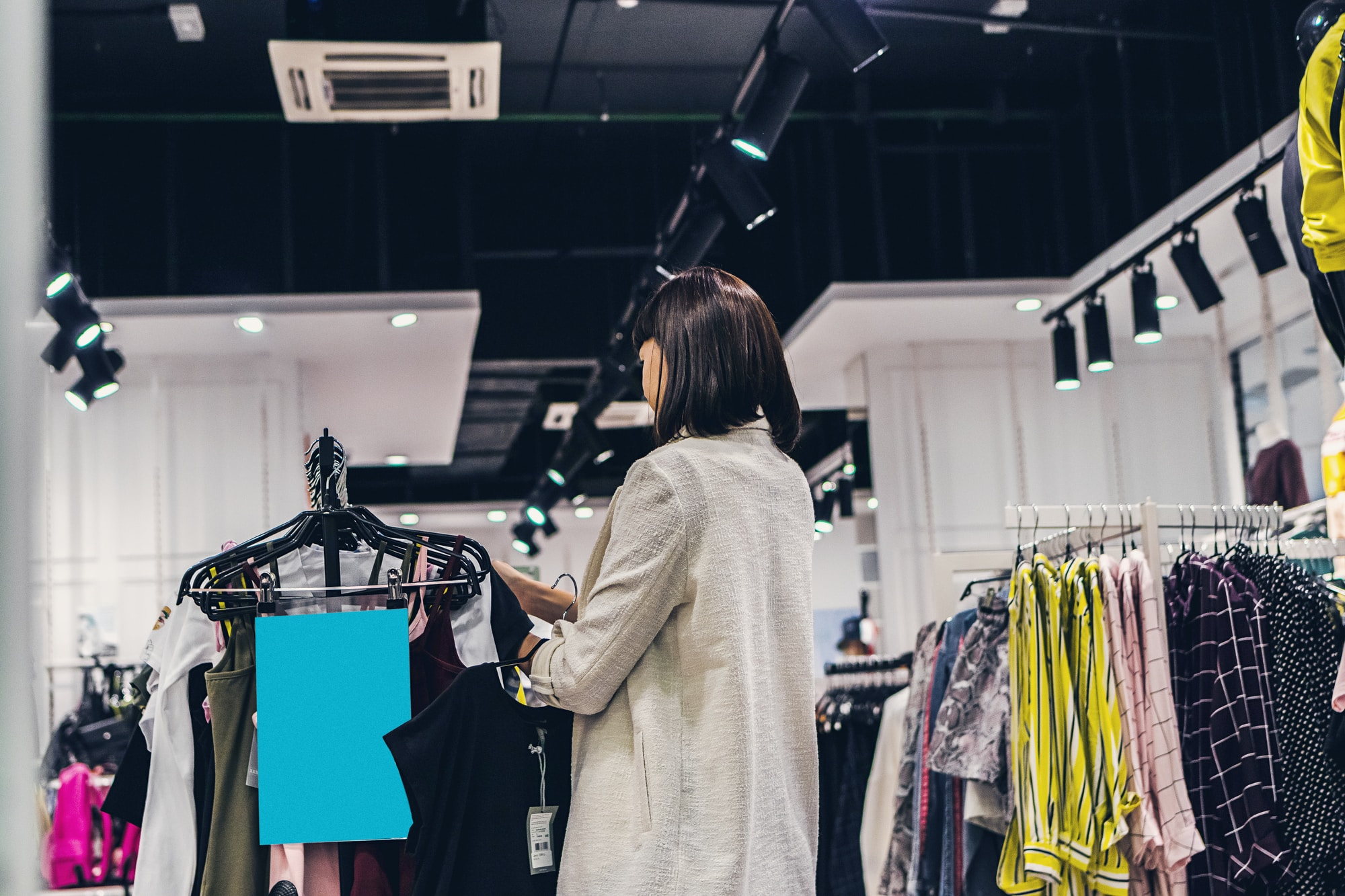 woman browsing clothing in shop
